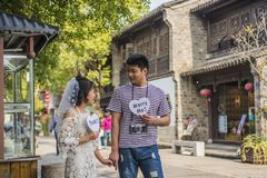 Young men and women taking wedding photos in Laomen East Scenic Area. A new couple taking wedding photos in the old scenic area of Laomen, taken in Nanjing royalty free stock photo