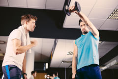 Young men working out in gym or health club Stock Image