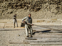 Young Men Working on the Pyramids. This picture is of young men working on repairing the Pyramid of Djoser, one of the oldest pyramids in the world. December Stock Photography