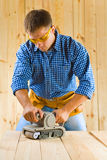 Young men works with detail sander Stock Image