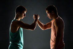 Young men wrestling Royalty Free Stock Photo