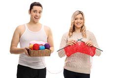 Young man and a young woman knitting together stock photography