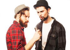Young mens singing with microphone Royalty Free Stock Photo