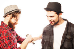Young mens singing with microphone Royalty Free Stock Image