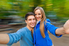 Young merry couple autumn outdoor Royalty Free Stock Images