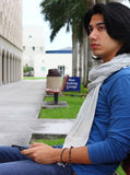 Young Metrosexual Male. Young attractive metrosexual male sitting on a bench in stylish clothing Royalty Free Stock Photo