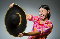 The young mexican man wearing sombrero Stock Images