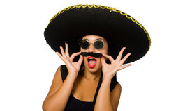 The young mexican woman wearing sombrero isolated on white. Young mexican woman wearing sombrero isolated on white royalty free stock photos