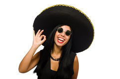 The young mexican woman wearing sombrero isolated on white. Young mexican woman wearing sombrero isolated on white Stock Photo
