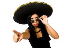 The young mexican woman wearing sombrero isolated on white. Young mexican woman wearing sombrero isolated on white Royalty Free Stock Photography
