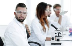 Microbiologist and his colleagues are sitting in a modern laboratory Royalty Free Stock Image