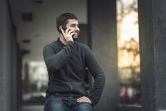 Handsome young man talking on his phone in an urban area Royalty Free Stock Photos