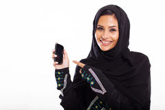 Middle eastern woman. Young middle eastern woman pointing at smart phone isolated on white Stock Photography