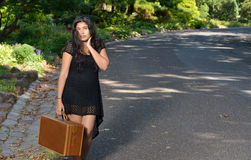 Young Middle Eastern woman with suitcase Royalty Free Stock Photos