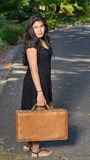 Young Middle Eastern woman with suitcase Royalty Free Stock Photo