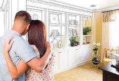Young Military Couple Facing Custom Built-in Shelves and Cabinet royalty free stock images