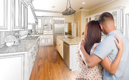 Free Young Military Couple Inside Custom Kitchen And Design Drawing C Stock Photography - 65428412
