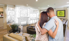 Young Military Couple Inside Custom Room and Design Drawing Stock Image