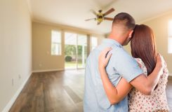 Young Military Couple Looking At Empty Room of New House stock images