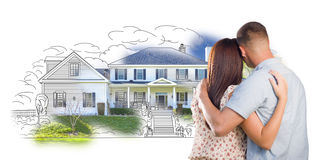 Young Military Couple Looking At House Drawing and Photo on White Stock Photography