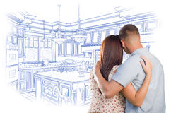 Young Military Couple Looking Over Custom Kitchen Design Drawing Royalty Free Stock Photos