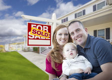 Young Military Family in Front of Sold Sign and House Stock Photos