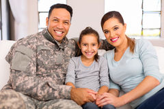 Young military family sitting Stock Image