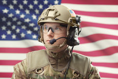 Young military man wearing helmet with USA flag on background - studio shot Stock Photography