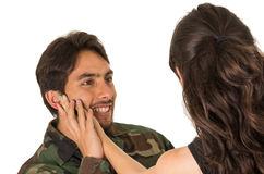 Young military soldier returns to meet his wife Stock Images