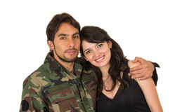 Young military soldier returns to meet his wife Royalty Free Stock Image