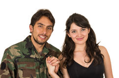 Young military soldier returns to meet his wife. Girlfriend holding hands isolated on white Royalty Free Stock Photos
