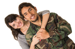 Young military soldier returns to meet his wife Royalty Free Stock Photos