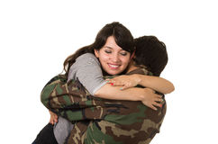 Young military soldier returns to meet his wife Royalty Free Stock Photography