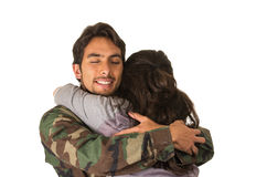 Young military soldier returns to meet his wife Stock Photography