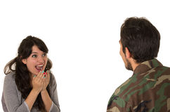 Young military soldier returns to meet his wife Stock Photo