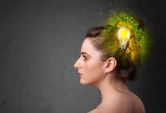 Young mind thinking of green eco energy with lightbulb Royalty Free Stock Photo