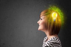 Young mind thinking of green eco energy with lightbulb. On grungy background Stock Photo