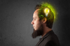 Young mind thinking of green eco energy with lightbulb Stock Photography