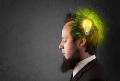 Young mind thinking of green eco energy with lightbulb Royalty Free Stock Photos