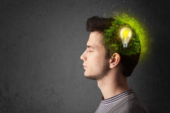 Young mind thinking of green eco energy with lightbulb Stock Photos