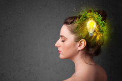 Young mind thinking of green eco energy with lightbulb Royalty Free Stock Images