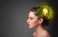 Young mind thinking of green eco energy with lightbulb Stock Photo