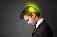 Young mind thinking of green eco energy with lightbulb Stock Images