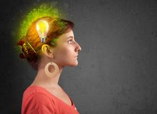 Young mind thinking of green eco energy with lightbulb. On grungy background royalty free stock photos