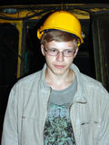 The young miner. Against tunnelling machine stock photos