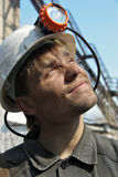 Young miner's helmet in a white Royalty Free Stock Image