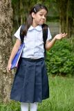 Young Minority Student Child Making A Decision Wearing School Uniform With Books