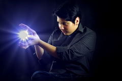 Young miracle man and glowing ball Royalty Free Stock Photography
