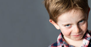 Young mischievous child teasing with grumbling look for joke Royalty Free Stock Photography