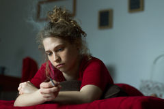 Young miserable woman feeling secluded Royalty Free Stock Photography